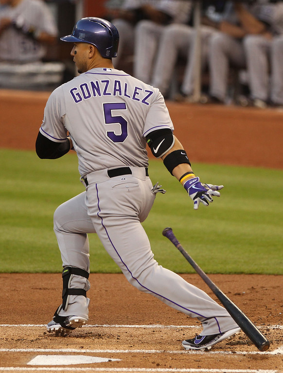 . Carlos Gonzalez #5 of the Colorado Rockies hits an RBI against the Miami Marlins during the second inning at Marlins Park on April 2, 2014 in Miami, Florida.  (Photo by Marc Serota/Getty Images)