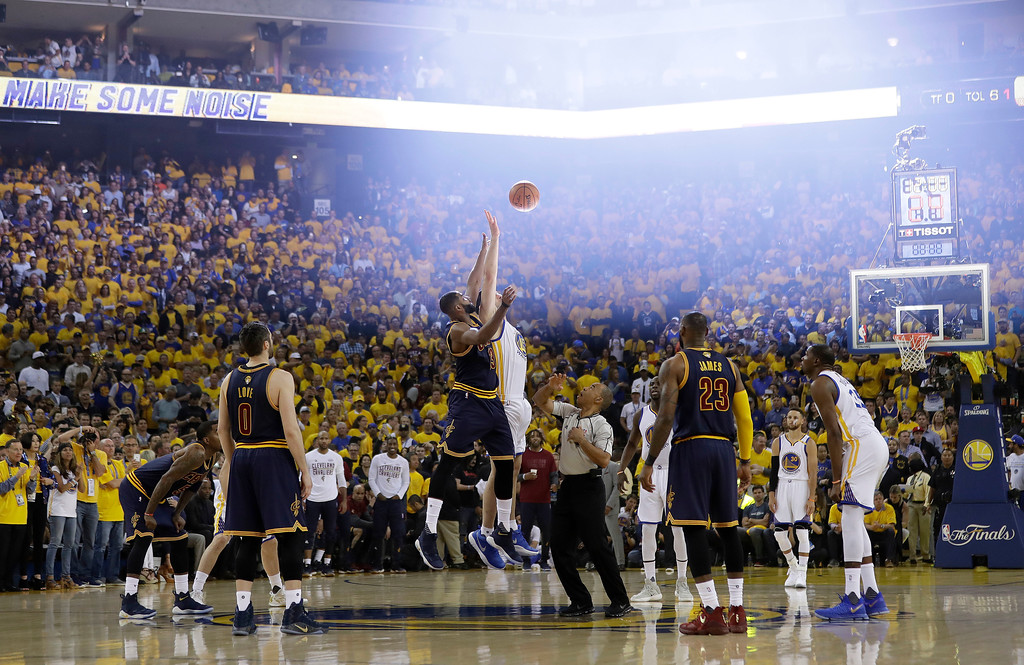 . Cleveland Cavaliers center Tristan Thompson, center left, and Golden State Warriors center Zaza Pachulia, center right, jump for the opening tip off during the first half of Game 1 of basketball\'s NBA Finals in Oakland, Calif., Thursday, June 1, 2017. (AP Photo/Marcio Jose Sanchez)
