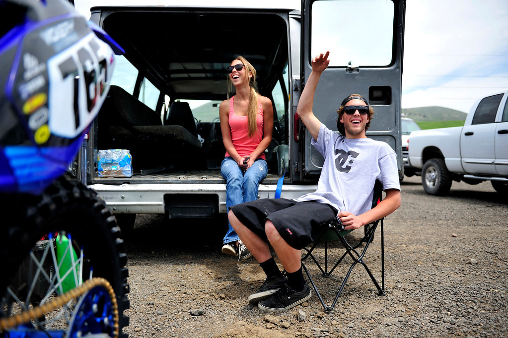 . Lakewood, CO. - MAY 23: #765 Mike Giese of Sedalia, Colo., and girlfriend Krystin Nolin of Littleton Colo., socialize with other riders as he waits for his  practice laps during a media day at the Thunder Valley Motocross Park in Lakewood, Colo. May 23, 2013. The practice was part of a media day event promoting coverage for the 2013 AMA Thunder Valley National the next day. (Photo By Manuel J. Martinez/The Denver Post)