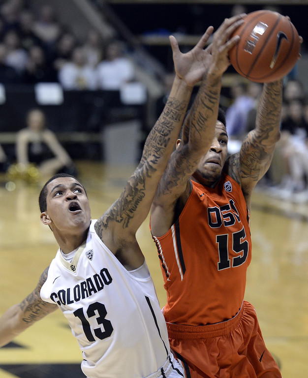 . Colorado\'s Dustin Thomas fights for a rebound with Oregon State\'s Eric Moreland during an NCAA college basketball game Thursday, Jan. 2, 2014, in Boulder, Colo. Jeremy Papasso/Daily Camera