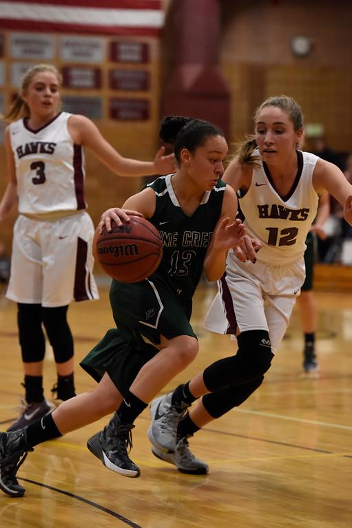 . THORNTON, CO - MARCH 01: Pine Creek Gabi O\'Connor (13) drives on Horizon Alyssa Jimenez (12) during the Girls Class 5A Sweet 16 game March 1, 2016 at Horizon HS. (Photo By John Leyba/The Denver Post)