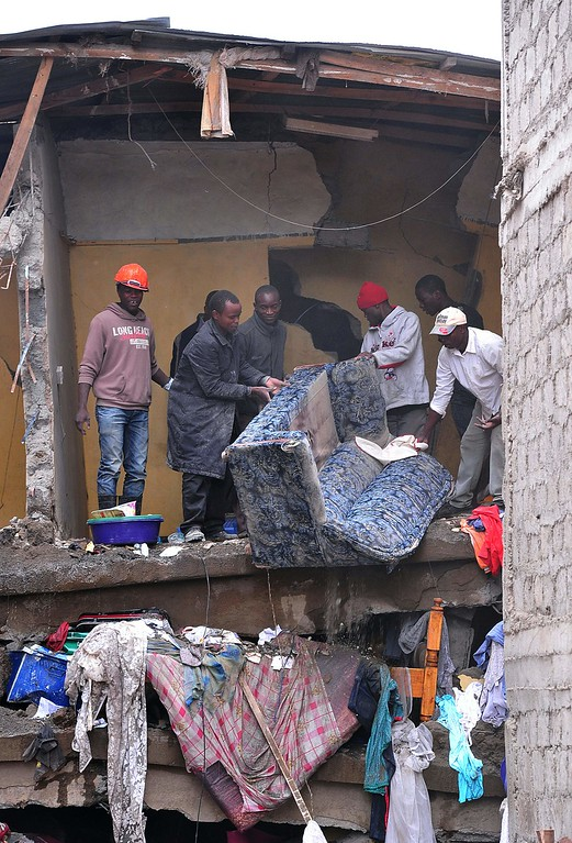 . Emergency personnel clear debris after a building collapsed in Nairobi on April 30, 2016.  / AFP PHOTO / SIMON MAINA/AFP/Getty Images