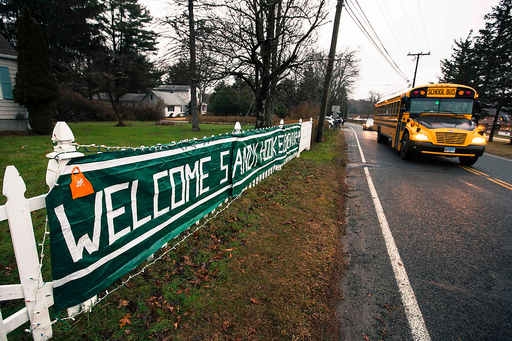 . A school bus drives past a welcome sign outside of the entrance for Chalk Hill Middle School where students displaced from Sandy Hook Elementary School will begin their classes on Tuesday, in Monroe, Connecticut, December 17, 2012. Twelve girls, eight boys and six adult women were killed in a shooting on Friday at Sandy Hook Elementary School in Newtown.  REUTERS/Lucas Jackson