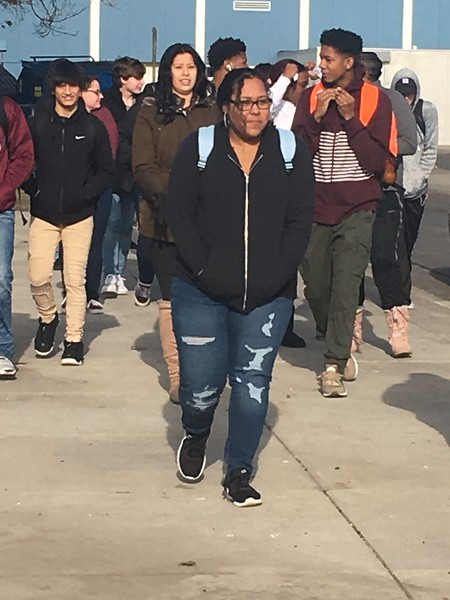 Lincoln Park High School students walked out onto the football field where they held signs saying LPHS IS PARKLAND STRONG. Dave Herndon – The News-Herald