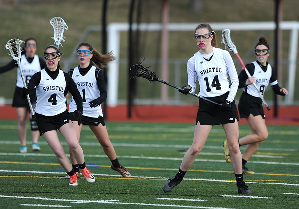 4/11/2018 Mike Orazzi | Staff Bristol Co-op lacrosse's Erika Santilli (4) and Ashley Watson (14) at Bristol Central Wednesday.
