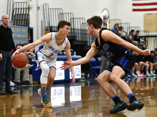 2/18/2020 Mike Orazzi | StaffrBristol Eastern High School's Elijah Parent (2) and Tolland's Josh Tubbs (14) in Bristol on Tuesday night. r