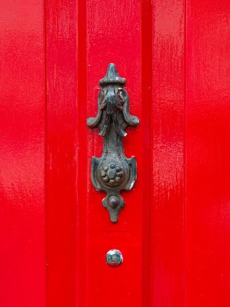 Close-up of peephole against red door, Sligo, County Sligo, Ireland