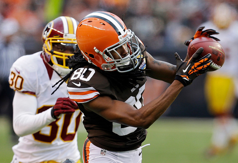 . Cleveland Browns wide receiver Travis Benjamin (80) catches a pass in front of Washington Redskins cornerback DJ Johnson (30) and goes 69 yards for a touchdown in the fourth quarter of an NFL football game on Sunday, Dec. 16, 2012, in Cleveland. (AP Photo/Tony Dejak)