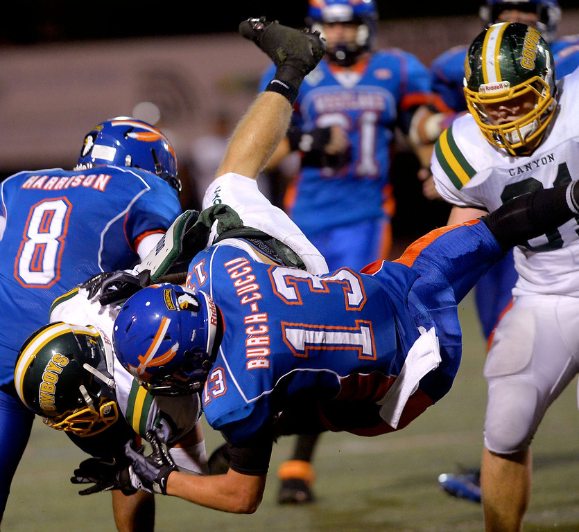 . Canyon High School ball carrier Zach Cuha is brought down by Westlake High\'sJesse Cuccia August 30, 2013 in Westlake Village, CA.(Andy Holzman/Los Angeles Daily News)