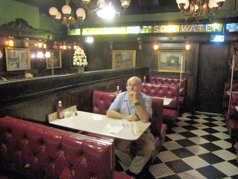 Patron pensively awaits menu.