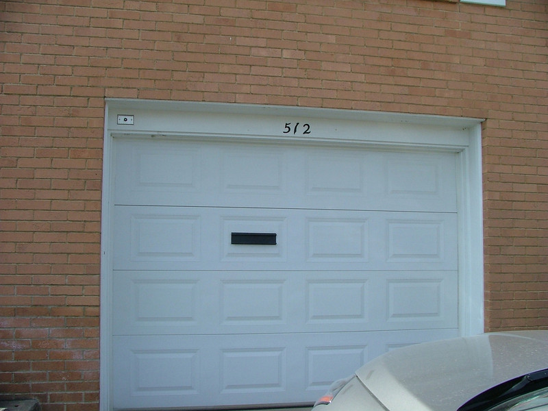 garage door with mail slot