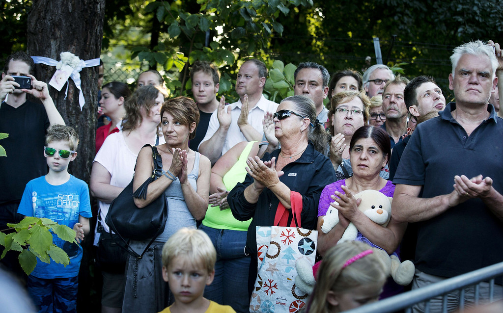 . Mourners applaud as a convoy of funeral hearses rides on July 24, 2014 to the Korporaal van Oudheusdenkazerne in Hilversum, where the bodies of the in total 298 victims of the Malaysia Airlines MH17 plane crash in eastern Ukraine arrive from Kharkiv, Ukraine, will be examined. A Dutch Air Force C-130 Hercules plane and an Australian Royal Australian Air Force C17 transported the remains. Dozens more bodies from the crash site of Malaysia Airlines flight MH17 are set to arrive in the Netherlands on July 24, as the EU prepares to hit Russia with fresh sanctions. AFP PHOTO / ANP / REMKO DE WAAL   AFP PHOTO ANP PIROSCHKA VAN DE WOUW   -/AFP/Getty Images