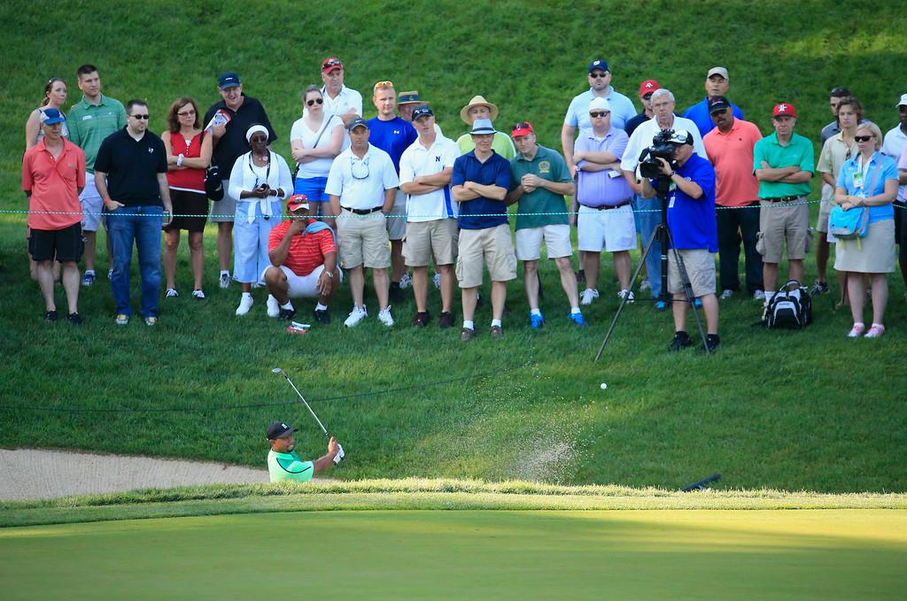 . BETHESDA, MD - JUNE 26:  Tiger Woods of the United States hits out of the sand trap on the tenth hole during a first round of the Quicken Loans National at Congressional Country Club on June 26, 2014 in Bethesda, Maryland.  (Photo by Rob Carr/Getty Images)
