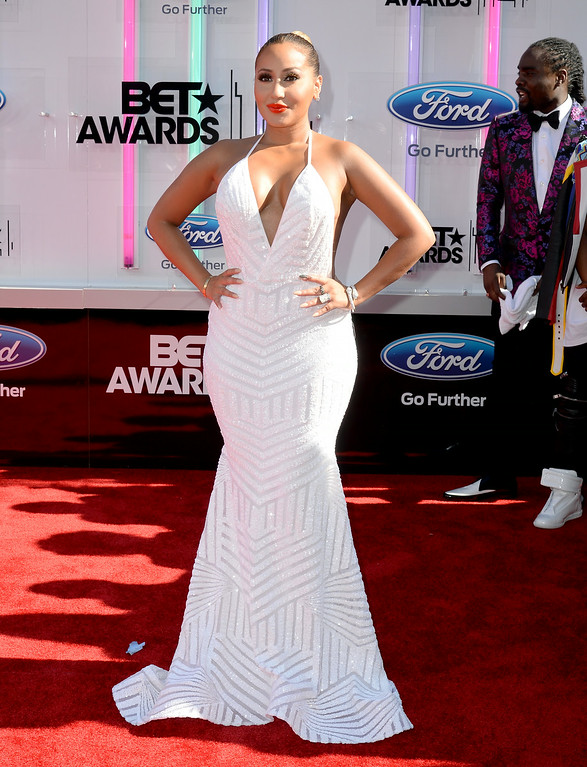 . Singer-songwriter Adrienne Bailon attends the BET AWARDS \'14 at Nokia Theatre L.A. LIVE on June 29, 2014 in Los Angeles, California.  (Photo by Earl Gibson III/Getty Images for BET)