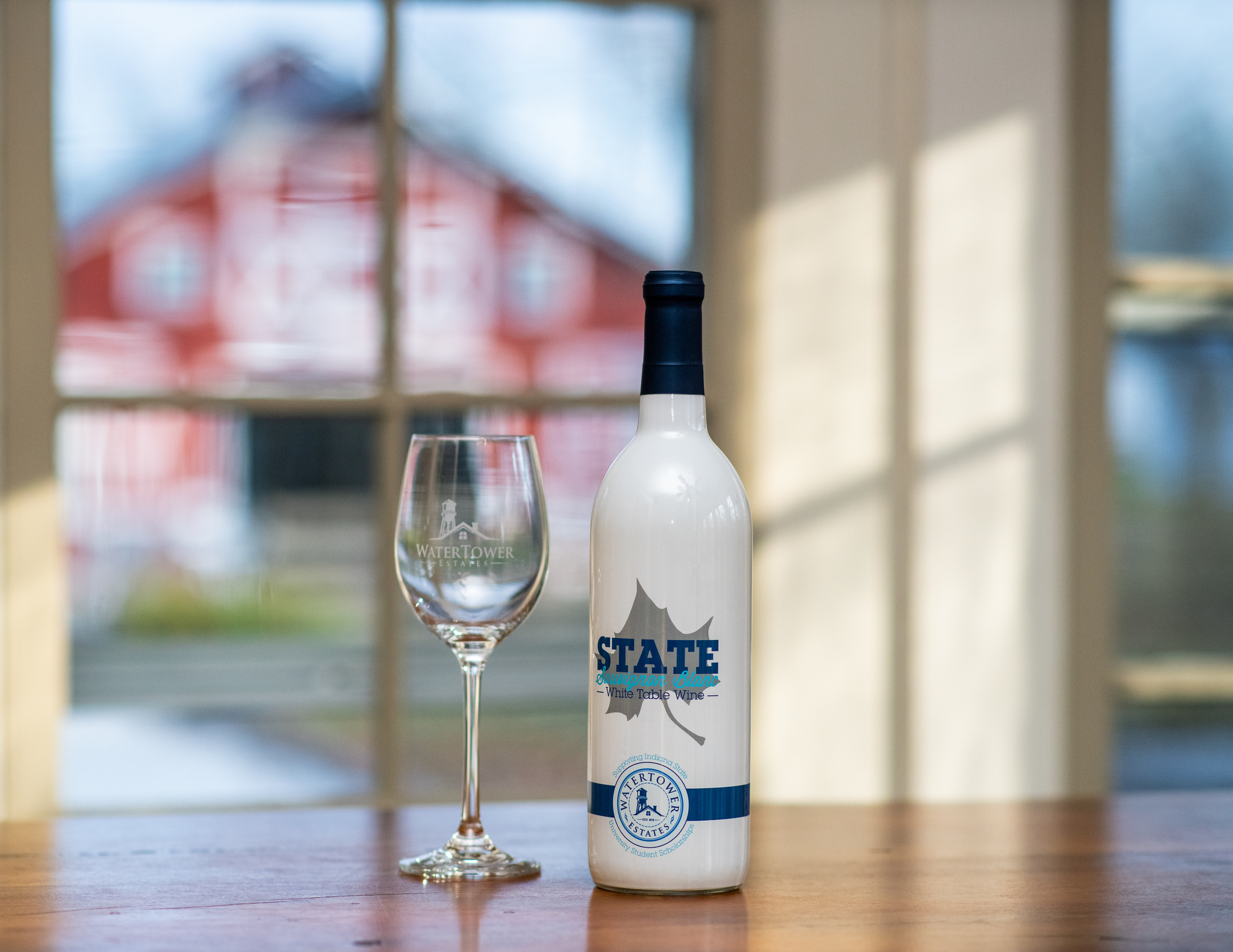 Photo of glass and State Sauvignon Blanc bottle
