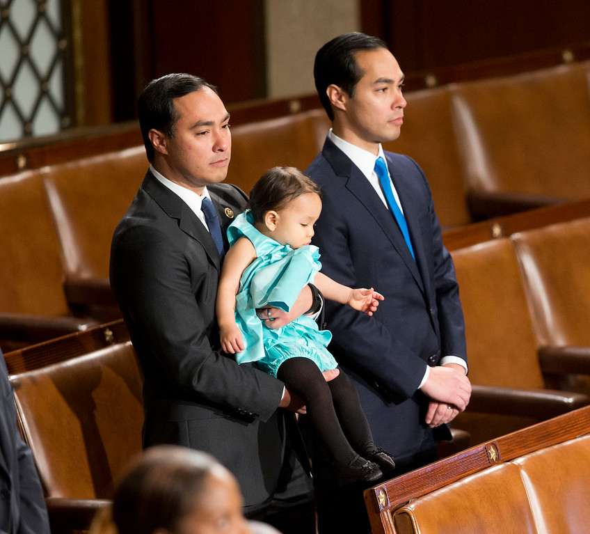 . Rep. Joaquin Castro, D-Texas, left, holds his daughter, Andrea Elena Castro, as he stand with his brother, Housing and Urban Development Secretary Julian Castro as they join other members of the House of Representatives for opening session of the 114th Congress, on Capitol Hill in Washington, Tuesday, Jan. 6, 2015, as Republicans assume full control for the first time in eight years. House Speaker John Boehner of Ohio, is expected to win a third despite a tea party-backed effort to unseat him, and Sen. Mitch McConnell, R-Ky., ascends to majority leader of the Senate after Democrats lost control the wake of November\'s midterm elections. (AP Photo/Pablo Martinez Monsivais )