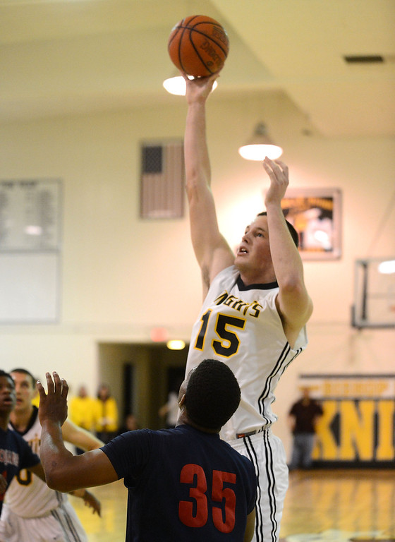 . Bishop Montgomery\'s Stefan Jovanovic (15) skies over La Verne Lutheran in a CIF SS Division IV-AA semifinal game in Torrance Friday night. Lutheran stunned Bishop Montgomery 63-59, ending their unbeaten season. 20130222 Photo by Steve McCrank / Staff Photographer