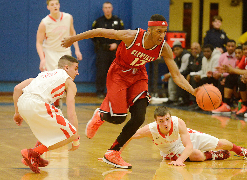. Maribeth Joeright/MJoeright@News-Herald.com<p> Glenville\'s Jonathan Walker steals the ball from Mentor during the second quarter of the Division I district semifinal game in Euclid, March 6, 2014.