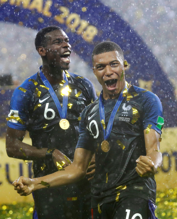 . France\'s Paul Pogba, rear and Kylian Mbappe celebrate after the final match between France and Croatia at the 2018 soccer World Cup in the Luzhniki Stadium in Moscow, Russia, Sunday, July 15, 2018. France won the final 4-2. (AP Photo/Matthias Schrader)