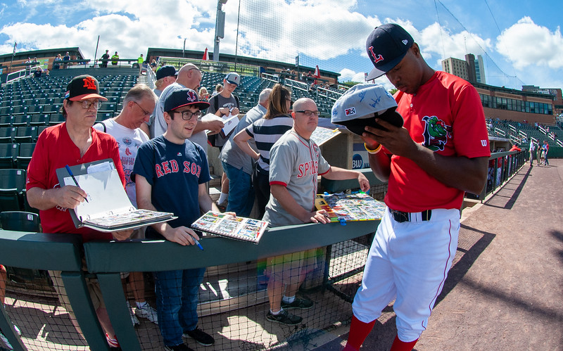 Gilberto Jimenez (32) signs autographs for the fans during Game 1 of the New York-Penn League championship series between the Lowell Spinners and Brooklyn Cyclones on Sunday at LeLacheur Park in Lowell. Lowell dropped Game 1 of the New York-Penn League championship series, 2-1, at home on Sept. 8, 2019. This is the first time in the Spinners' 24-year history that the team has reached the title series. (Lowell Sun / John Corneau)