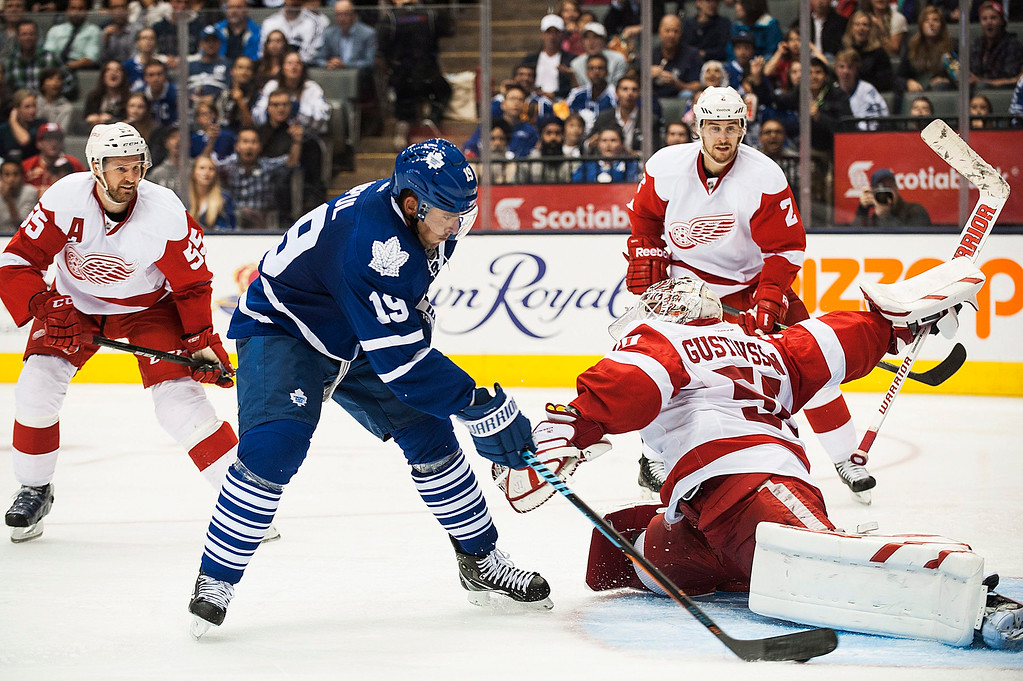 . Toronto Maple Leafs\' Joffrey Lupul (19) goes to the net against Detroit Red Wings goalie Jonas Gustavsson during second-period preseason NHL hockey game action in Toronto, Friday, Oct. 3, 2014. (AP Photo/The Canadian Press, Aaron Vincent Elkaim)
