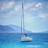Luxury sailboat anchored in the waters of the British Virgin Islands.
