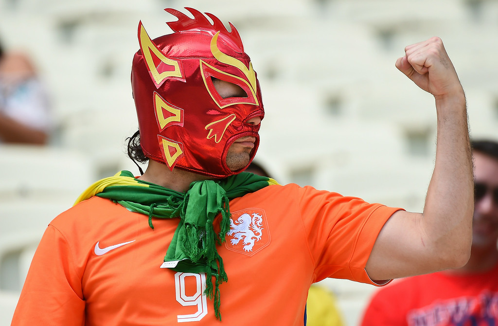 . A Netherlands supporter cheers for his team ahead of the Round of 16 football match between Netherlands and Mexico at Castelao Stadium in Fortaleza during the 2014 FIFA World Cup on June 29, 2014.   EMMANUEL DUNAND/AFP/Getty Images