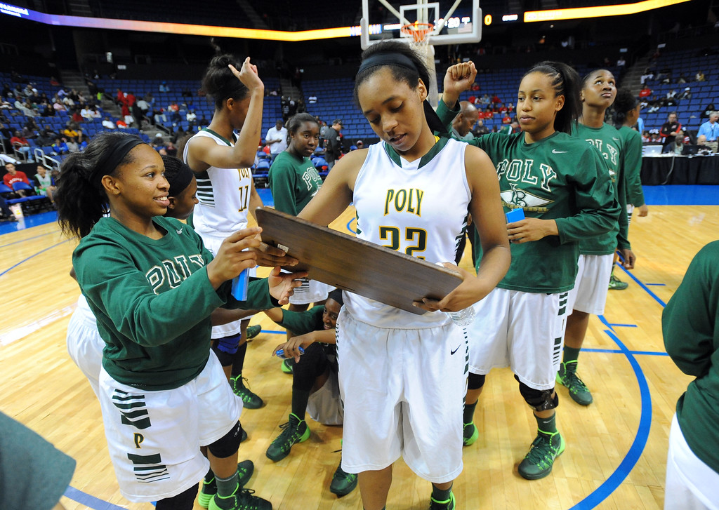 . Poly\'s Jade Matthews inspects the championship plaque after their win at Citizens Business Bank Arena in Ontario, CA on Saturday, March 22, 2014. Long Beach Poly vs Etiwanda in the CIF girls open division regional final. 2nd half, Poly won 56-46. Photo by Scott Varley, Daily Breeze)