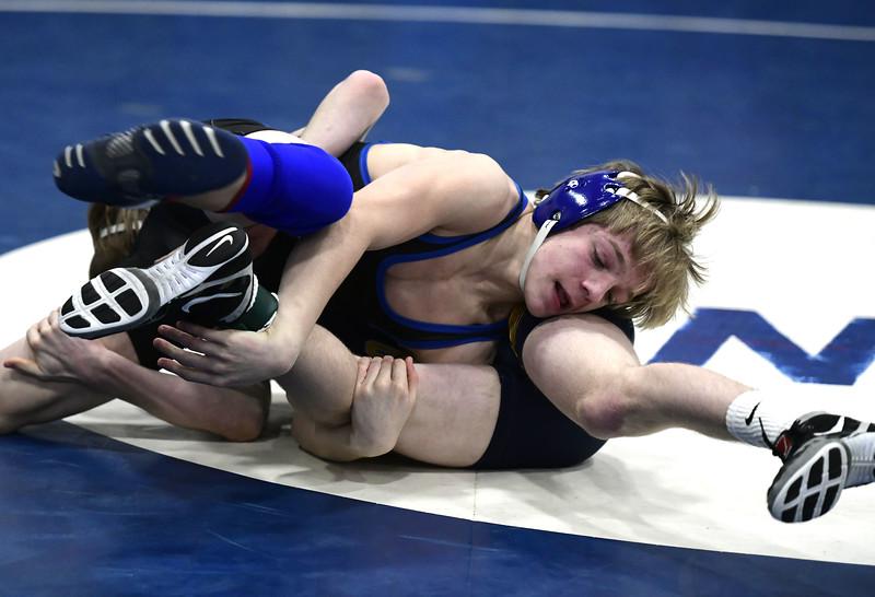 1/26/2019 Mike Orazzi   Staff Bristol Eastern's Mason Lishness and Simsbury's Alex Kasson wrestle at Southington High School Saturday.