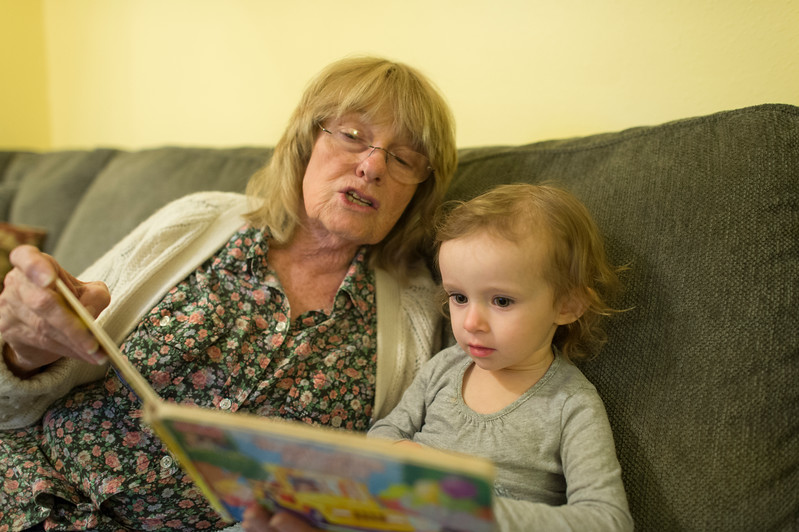 grandma reads to little camille