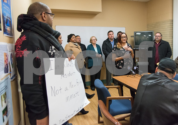 11/29/17 Wesley Bunnell | Staff State Representative Robert Sanchez called a conference Wednesday evening at HRA on Oak St to address allegedly racial comments made by former mayor and current president of the Chamber of Commerce Tim Stewart on Facebook. Ward 3 resident Edgar Lopez who also manages property in the neighborhood holds a sign reading I'm a New Britain resident not a New Britain inmate in reply to Stewart's posting as Anette Velez speaks. Stewart left the message in reply to Velez's Facebook post.
