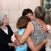 GOP Primary Mary Ann Jacob hugs her sisters