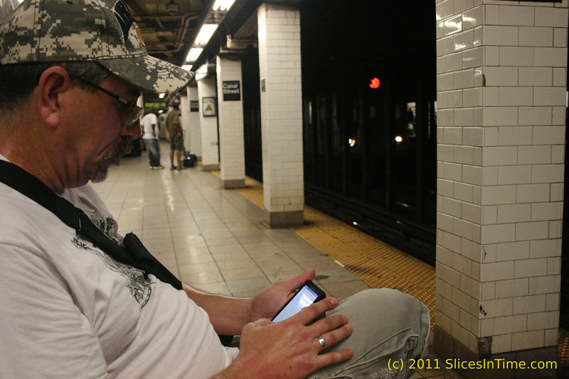 Waiting for the train at the Canal Street subway platform, New York