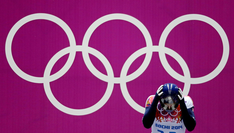. Dominic Parsons of Great Britain prepares for his second run during the men\'s skeleton competition at the 2014 Winter Olympics, Friday, Feb. 14, 2014, in Krasnaya Polyana, Russia. (AP Photo/Natacha Pisarenko)