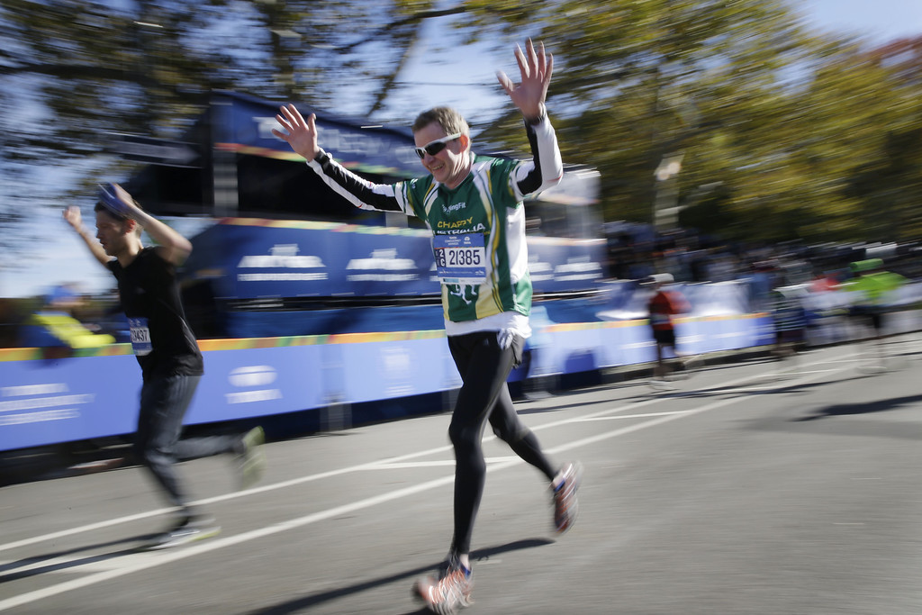 . Runners celebrate as they arrive at the finish line of the 2014 New York City Marathon in New York, Sunday, Nov. 2, 2014. (AP Photo/Seth Wenig)