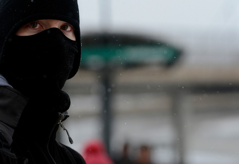 . Matt Brenholtz waits for a train at the light rail station in downtown in Littleton, CO April 09, 2013. A winter storm has blown into northeastern Colorado, with strong winds and below-freezing temperatures creating blizzard-like conditions at times. (Photo By Craig F. Walker/The Denver Post)