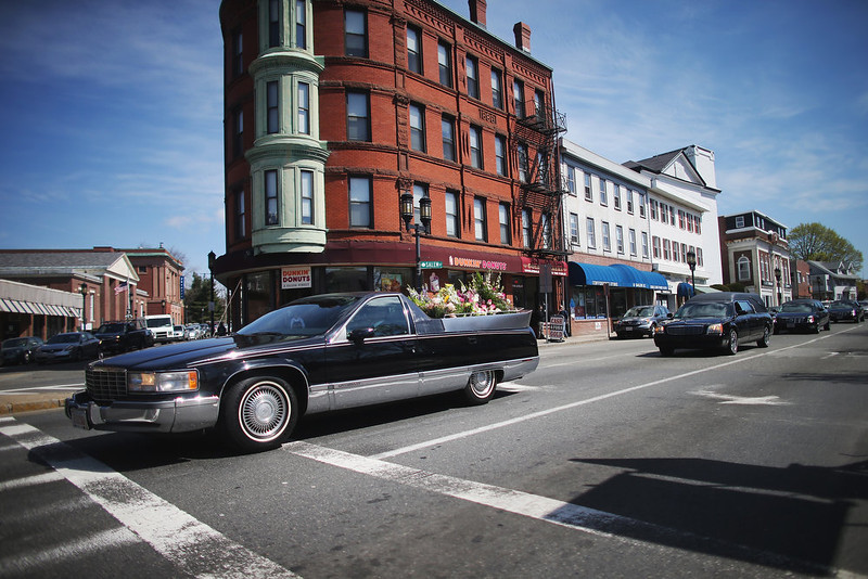 . The funeral procession passes through town for 29-year-old Krystle Campbell, who was one of three people killed in the Boston Marathon bombings, on April 22, 2013 in Medford, Massachusetts. The 29-year-old restaurant manager, raised in Medford, Massachusetts, Massachusetts, was killed April 15, in the blasts at the finish line of the Boston Marathon. Massachusetts Gov. Deval Patrick has asked residents to observe a moment of silence at the time of the first explosion at 2:50 p.m. this afternoon.  (Photo by Mario Tama/Getty Images)
