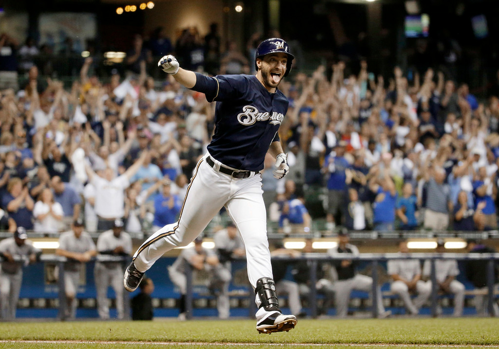 . Milwaukee Brewers\' Ryan Braun reacts after hitting a game-winning single during the ninth inning of a baseball game against the Colorado Rockies on Friday, June 27, 2014, in Milwaukee. The Brewers won 3-2. (AP Photo/Morry Gash)
