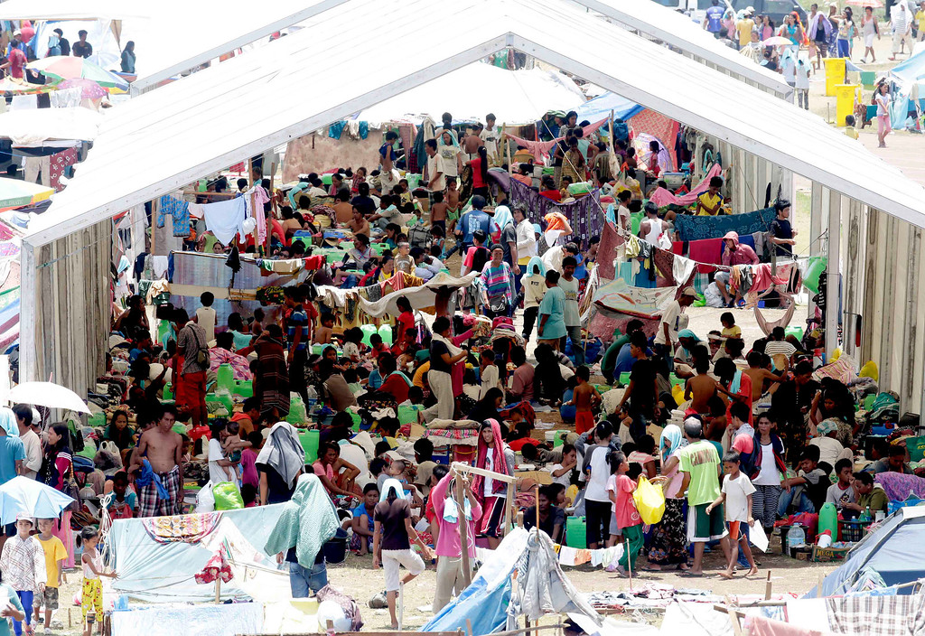 . Villagers who were displaced by the fighting between government forces and Muslim rebels continue to be housed in tents in a stadium in Zamboanga city in southern Philippines Friday, Sept. 20, 2013. The ongoing standoff has now displaced more than 100,000 people and resulted in billions of pesos (millions of dollars) losses to the city\'s business. (AP Photo/Bullit Marquez)