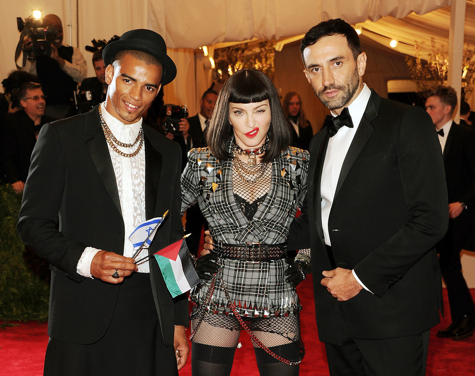 """. Brahim Zaibat, left,recording artist Madonna and designer Riccardo Tisci attend The Metropolitan Museum of Art\'s Costume Institute benefit celebrating \""""PUNK: Chaos to Couture\"""" on Monday, May 6, 2013 in New York. (Photo by Evan Agostini/Invision/AP)"""