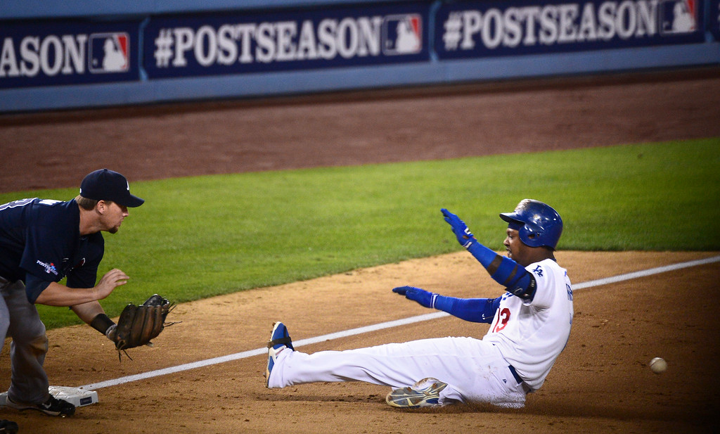 . Los Angeles Dodgers\' Hanley Ramirez makes a 3-base hit in the fourth inning as they play the Atlanta Braves during game 3 of the NLDS at Dodger Stadium Sunday, October 6, 2013.  (Photo by Sarah Reingewirtz/Los Angeles Daily News)