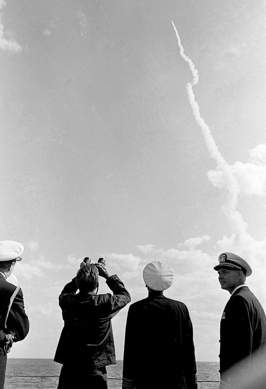 . President Kennedy uses binoculars to view a  Polaris missile that was fired from a 30 miles off Cape Canaveral, Fla., on Nov. 16, 1963.  Associated Press file