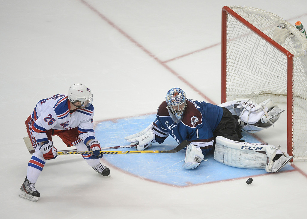 . Colorado goalie Semyon Varlamov (1) stopped an shootout attempt by New York wing Martin St. Louis (26) Thursday night.   (Photo by Karl Gehring/The Denver Post)