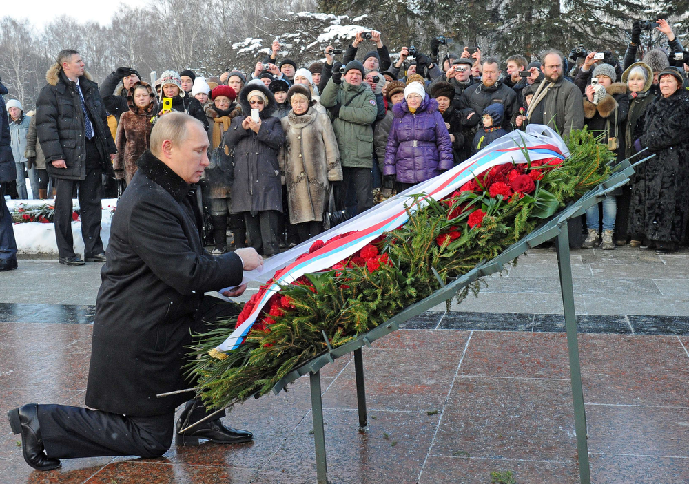 . Russia\'s President Vladimir Putin takes part in a wreath laying ceremony at the Piskarevskoye cemetery, the memorial to the more than 1 million people who perished during the 1941-1944 siege and blockade of Leningrad, now St.Petersburg, on January 27, 2014. Russia marked today the 70th anniversary of the breaking of the Nazi siege of Leningrad during World War II that saw more than a million people starve to death.The German and Finnish siege and blockade of Leningrad was broken on January 18, 1943 but finally lifted a year after, on January 27, 1944. The city\'s name was changed back from Leningrad to St. Petersburg after the 1991 Soviet collapse. (MIKHAIL KLIMENTYEV/AFP/Getty Images)