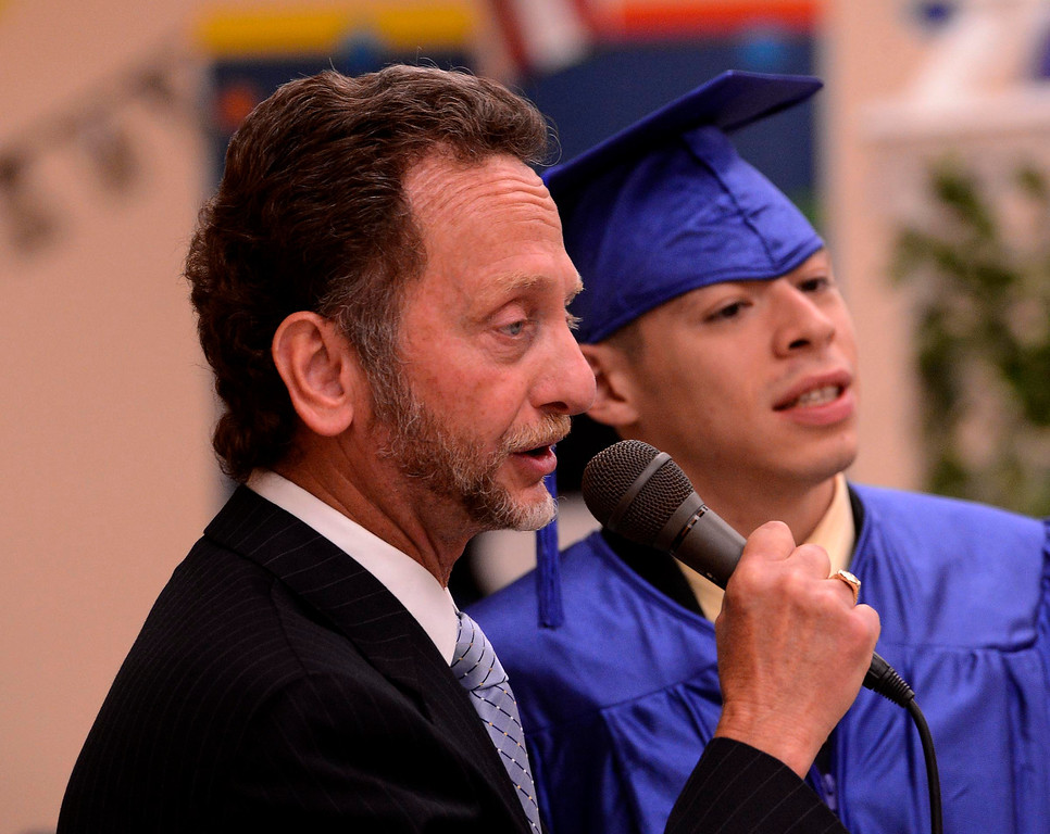 . Nick Cataldo speaks alongside graduate Alfredo Yanez during Commencement Ceremonies at Carl And Dora Anderson School in San Bernardino May 21, 2013.  GABRIEL LUIS ACOSTA/STAFF PHOTOGRAPHER.
