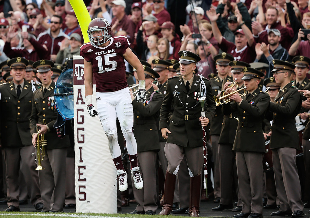 . COLLEGE STATION, TX - NOVEMBER 09:  Travis Labhart #15  of the Texas A&M Aggies celebrates after catching an 11 yard touchdown pass in the second quarter during the game against the Mississippi State Bulldogs at Kyle Field on November 9, 2013 in College Station, Texas.  (Photo by Scott Halleran/Getty Images)