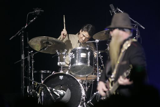 """. FILE - In this Jan. 18, 2005 file photo, Texas Gov. Rick Perry sits in on drums with ZZ Top during the \""""A Salute to the 2005 Presidential Inaugural,\"""" sponsored by the Texas Motor Transportation Association at the National Building Musuem in Washington. Bass player Dusty Hill is at right. Perry announced Monday, July 8, 2013, that he would not seek re-election as Texas governor next year. (AP Photo/The Dallas Morning News, Tom Fox, File)"""