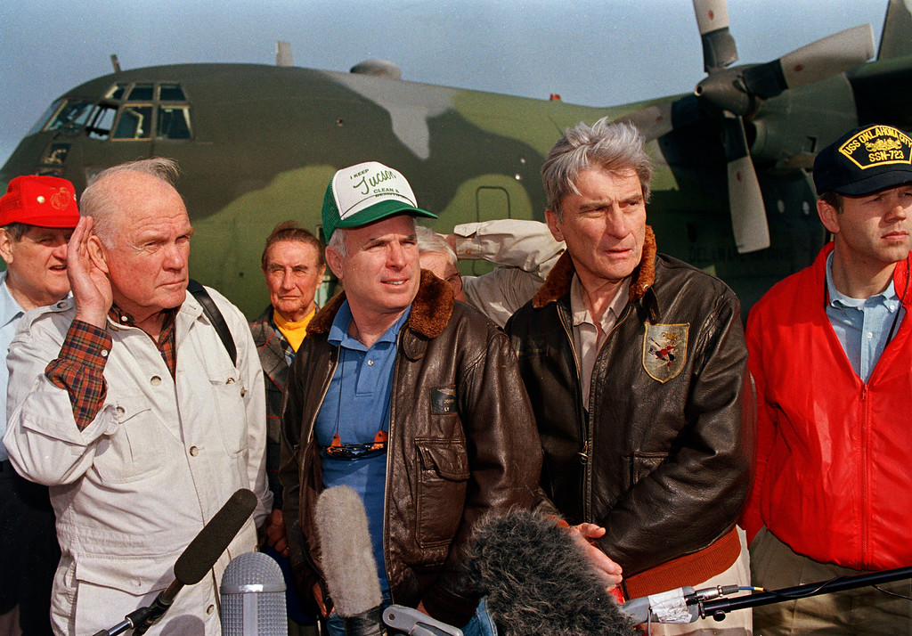 . U.S. Sen. John Glenn (D-Ohio), left, listens to a reporter\'s questions as fellow Sen. John S. McCain III (R-Ariz.), center, and Sen. John Warner (R-Va.) look on during a news conference at Dhahran Air Base, Saudi Arabia, March 17, 1991.  Glenn said he opposes sending U.S. troops into Iraq to topple Saddam Hussein.  (AP Photo/David Longstreath)