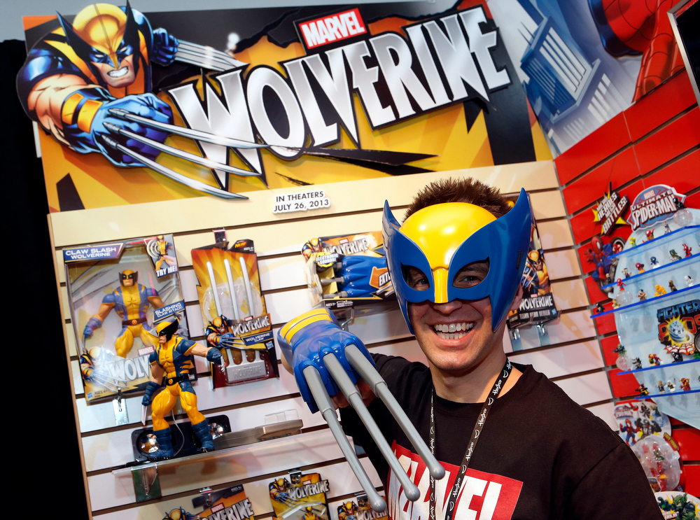 . Toy demonstrator Clayton Hodges dons the ìWolverine Hero Maskî and ìWolverine Electronic Claw,î based on the Marvel Comics character featured in the upcoming film ìThe Wolverineî in Hasbroís showroom at the American International Toy Fair, Saturday, Feb. 9, 2013, in New York. (Photo by Jason DeCrow/Invision for Hasbro/AP Images)