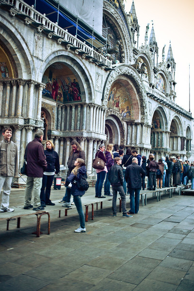 St Marks Square, people standing in line on platforms